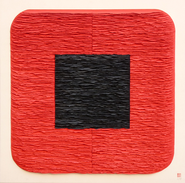 Black square on red square with rounded corners